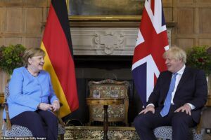 Read more about the article Angela Merkel BACKS DOWN after crunch talks with Boris Johnson and confirms double-jabbed Brits WILL be able to travel quarantine-free to Germany